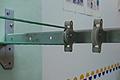 Cómo poner un tendedero de brazos de metal con poleas, cambiar y quitar el chirrido a las poleas
