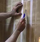 Quitar los azulejos abombados sin que se caigan